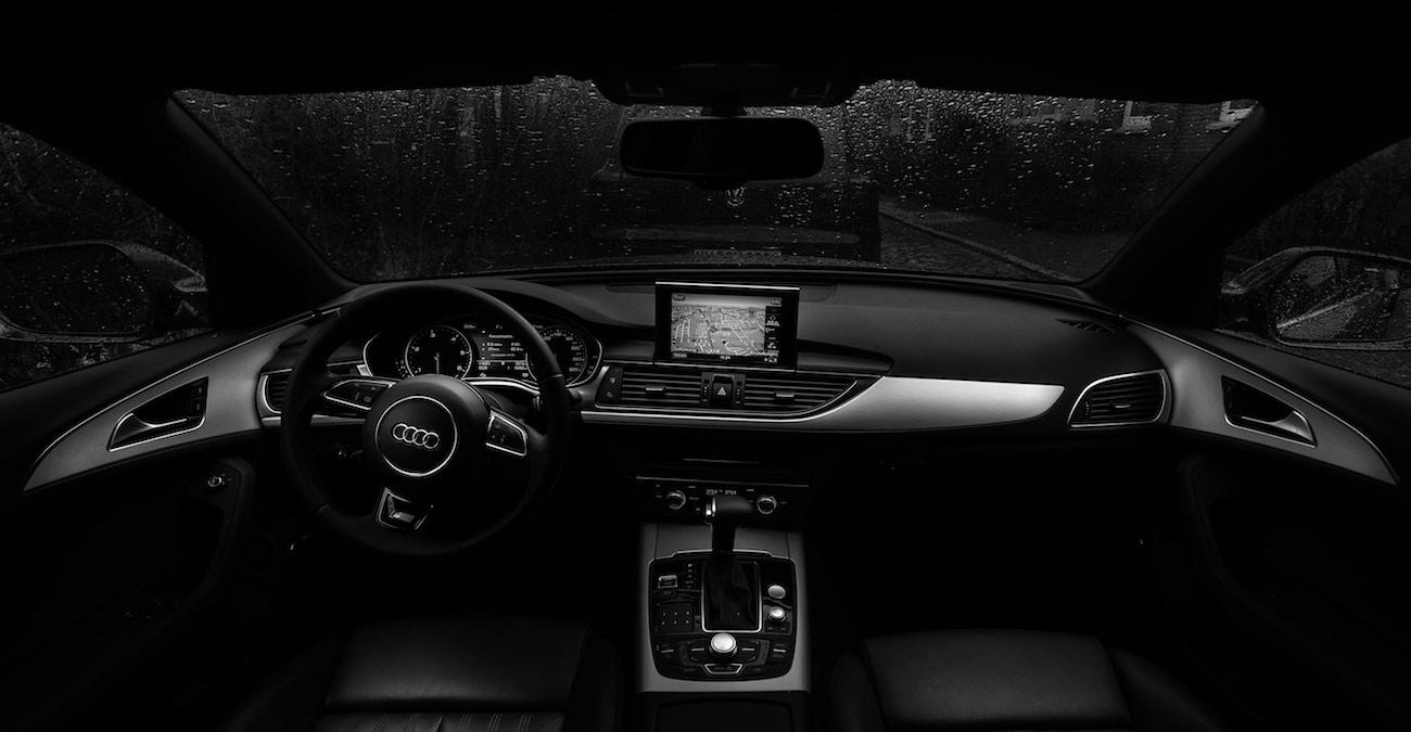 black and white Audi car interior looking out windshield